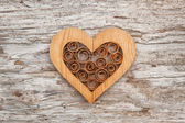 Wooden decorative heart on the old wood — Stock Photo