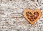 Wooden heart on the lace fabric and old wood — Stock Photo