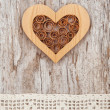 Wooden heart and lace fabric on the old wood — Stock Photo #47840395