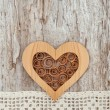 Wooden heart and lace fabric on the old wood — Stock Photo #47840401