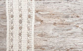 Lace fabric on the old wood — Stock Photo
