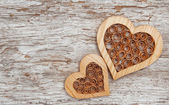 Wooden decorative hearts on the old wood — Stock Photo