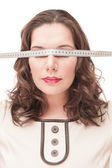 Plus size woman blindfold with centimeter  — Stock Photo