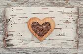 Wooden decorative heart on the birch bark — Stock Photo