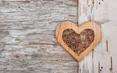 Wooden decorative heart on the birch bark — Stock Photo