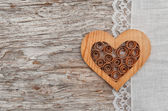 Wooden heart and linen fabric on the old wood — Stock Photo