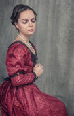 Sad beautiful woman in medieval dress — Foto de Stock