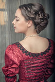 Beautiful medieval woman in red dress — Stock Photo