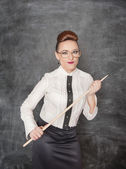 Strict teacher with wooden pointer — Stock Photo
