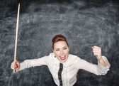 Angry screaming teacher with pointer — Stock Photo