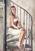 Beautiful steampunk woman on the stairway — Foto de Stock