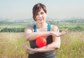 Beautiful woman exercising with ball — Stock Photo
