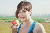 Beautiful fitness woman with apple — Stok fotoğraf