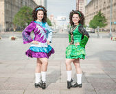 Two women in irish dance dresses posing — Stock Photo