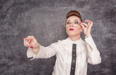 Strict teacher showing on someone by finger — Stock Photo