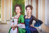 Two beautiful women in medieval dresses — Stock Photo