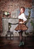 Beautiful steampunk woman posing — Stock Photo