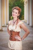 Beautiful woman in the corset — Stock Photo
