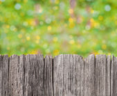 Empty rustic wooden board with abstract summer background — Stock Photo