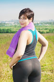 Fitness plus size woman with towel  — Stock Photo