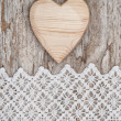 Wooden heart on the lace fabric and old wood — Stock Photo #51718393