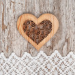 Wooden decorative heart on the lace fabric and old wood — Stock Photo #51718395