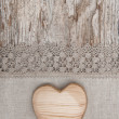 Wooden heart on the lace fabric and old wood — Stock Photo #51718475