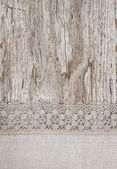 Lace and linen fabric on the old wood — Stock Photo