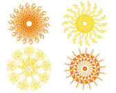 Set of four isolated vector suns — Stock Vector