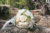 Wedding bouquet of the bride on a background of nature — Stock Photo