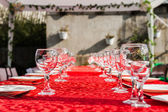 Wedding banquet table with glasses — Stock Photo