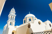 The temple and the bell in the town of Fira. Santorini island, G — Foto Stock