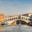 Rialto Bridge (Ponte Di Rialto) on a sunny day - Stock Photo