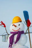 Lonely snowman at a snowy field — Stock Photo