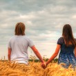 Couple staying at a wheat field — Stock Photo #19782521