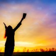 Woman staying with raised hands — Stock Photo #22284983