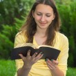 Teen girl reading book — Stock Photo