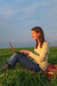 Teen girl with a laptop — Stock Photo