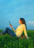 Teen girl reading electronic book — 图库照片