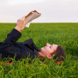 Teen girl reading the Bible outdoors — Foto Stock