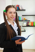 Teenage girl with a book — Stockfoto