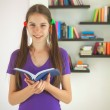 Teenage girl with a book — Stock Photo