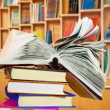 Foto Stock: Open book on stack of books