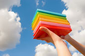 Hands holding colorful hard cover books — Стоковое фото