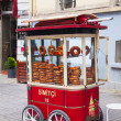 Mobile cart with simits (Turkish bagels) in Istanbul, Turkey — Stock Photo #29699809
