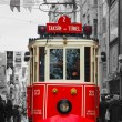 Stock Photo: Old-fashioned red tram at street of Istanbul