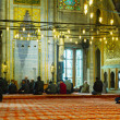 Stock Photo: Blue Mosque interior with muslims