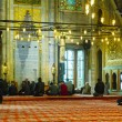 Stock Photo: Blue Mosque interior with the muslims