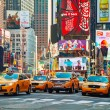 Yellow taxis at Times Square in New York City — Stock Photo