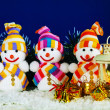 Three snowman with a lantern — Stock Photo